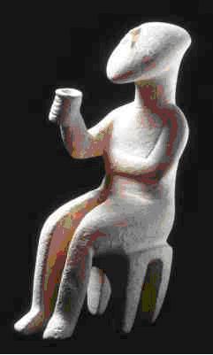 """Εικόνα 4: © Ίδρυμα Ν.Π. Γουλανδρή - Μουσείο Κυκλαδικής Τέχνης. Συλλογή Ν.Π. Γουλανδρή, αρ. 286 Ειδώλιο καθιστής μορφής - """"ο εγείρων πρόποσιν"""" μάρμαρο Κυκλαδικό Πρωτοκυκλαδική ΙΙ περίοδος - φάση Σύρου 2800-2300 π.Χ. Ύ.: 15,2 εκ. Άγνωστη προέλευση."""